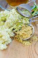Herbal tea from meadowsweet with strainer and cup