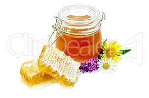 Honeycomb with a jar and flowers