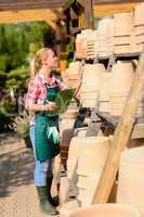 garden center woman check clay pots