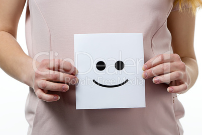 Smile in hands of pregnant woman