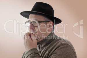 Serious man with hat and anxious glance