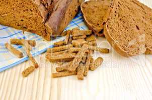 Rye homemade bread on board with crackers
