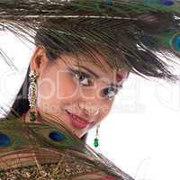 Indian girl with peacock feathers.