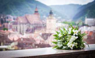 Wedding bouquet spring flowers with Brasov city view panoramic