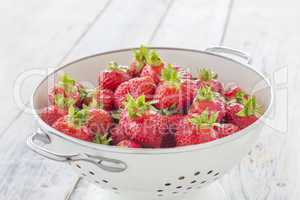 Strawberries in a sieve
