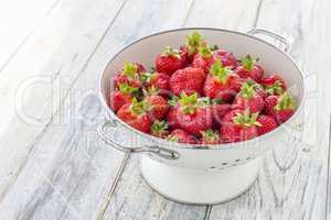 Strawberries in a sieve