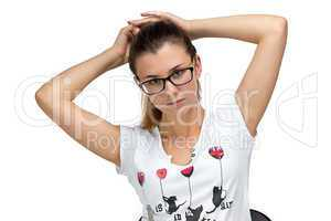 Teenager girl with glasses fixing her hair