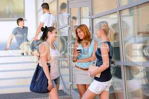 Student girls chatting together outside college