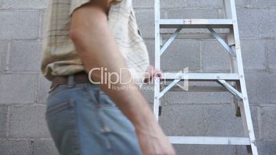 Male Climbing a Step Ladder