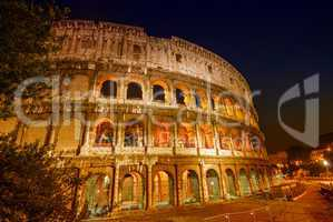 Stunning view of Colosseum at night, Rome - Italy