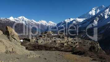 Old village near Manang and high mountains