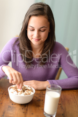 Dieting teenage girl eat cereal healthy breakfast