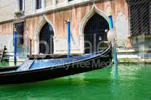 The gondola is on water channel, Venice, Italy