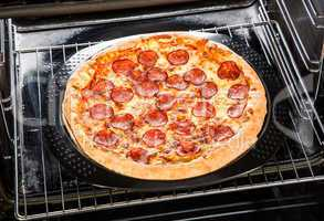 Pepperoni pizza in the oven.