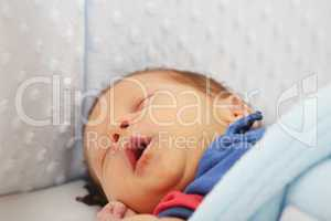 Newborn yawing.  Focus in the mouth