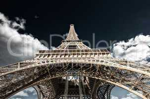 Paris. Powerful structure of Magnificent Eiffel Tower at sunset