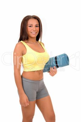 Teen girl with yoga matt.