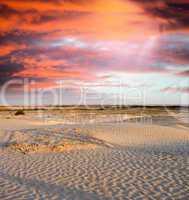 Spectacular sunset over the desert. Vertical composition.