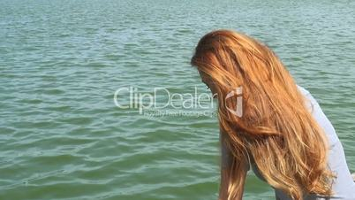 adult woman on a wooden pontoon