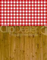 Traditioneller Hintergrund - Holz mit rot-weißer Tischdecke