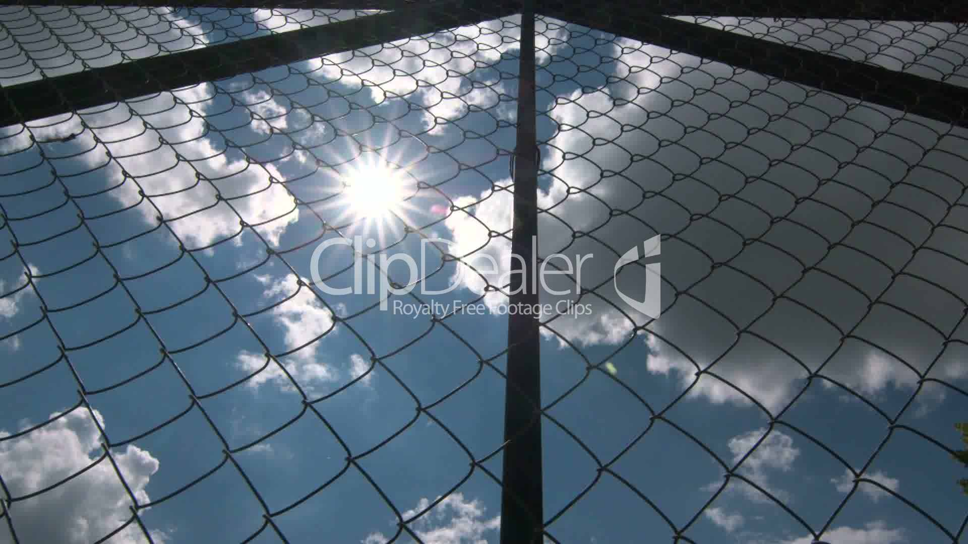 Dolly: Sun shining through the chain link iron wire fencing: Royalty ...