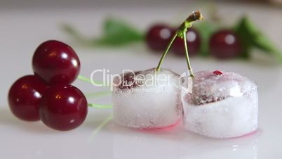 Fresh and frozen cherry fruit background closeup time-lapse