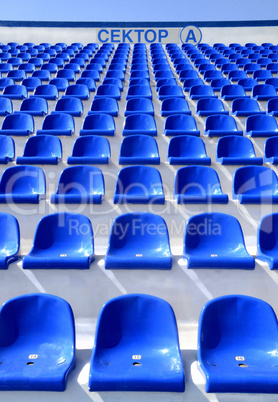 """sector of the stadium with the inscription """"A"""" with blue chairs"""