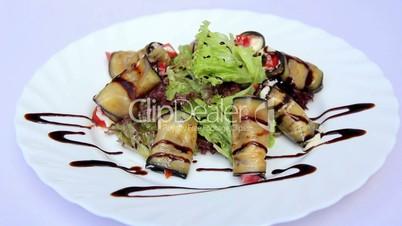Dish of eggplant and tomato.Eggplant rolls with sauce.