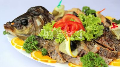 Fish dish with vegetables, stuffed with fish, seafood