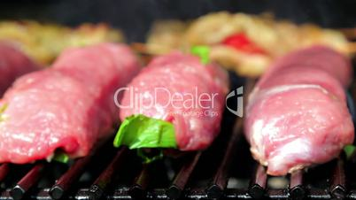 Meat roasted on an open fire, barbecue, pork, veal, chicken, meat rolls on fire