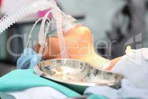 Patient with a breathing mask in operation room
