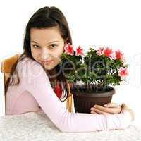 Teenage girl hugging her pot plant