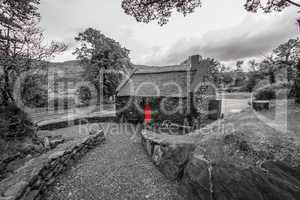 Mysterious stone home with red door