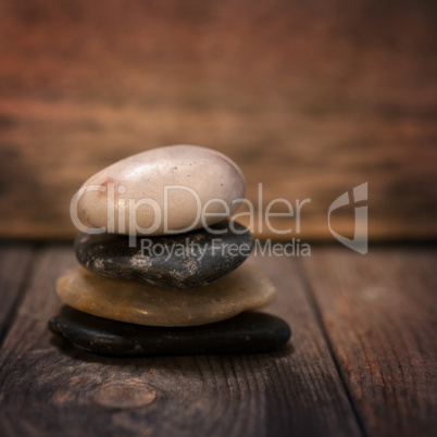 Pebbles stock on wooden background