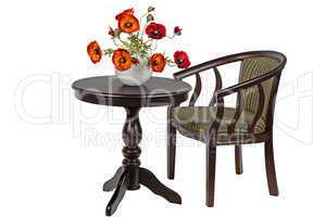 Bouquet of artificial poppies in a vase on the round table, isol
