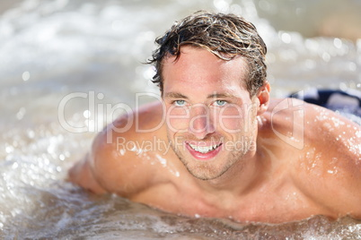 Beach man having fun in water