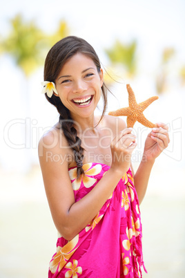 Summer vacation woman smiling happy with starfish