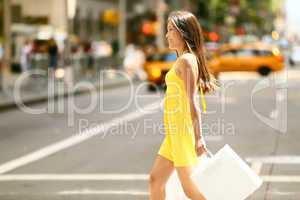 Shopping woman walking outside in New York City