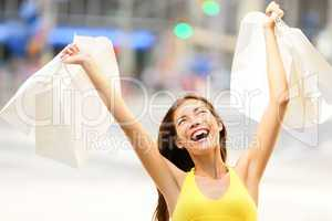 Happy shopping woman in excited winning