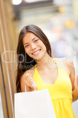 Shopping girl portrait with shopping bags outside