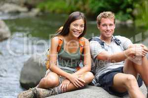 People hiking - resting hikers portrait at river