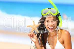 Beach travel woman with snorkel on vacation