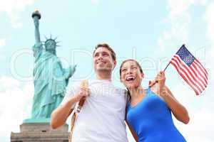 Tourists travel couple at Statue of Liberty, USA