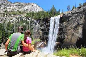 Hikers couple resting in Yosemite park - waterfall