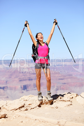 Happy hiker by Grand Canyon cheering