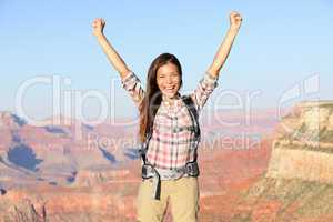 Happy winner hiker woman in Grand Canyon cheering