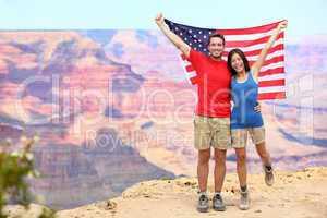USA travel tourist couple holding american flag