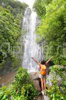 Happy hiker - Hawaii tourists hiking by waterfall