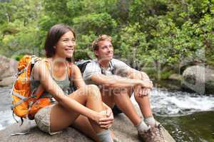 Hikers couple relaxing by river
