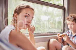 Teenagers girl and boy  in the train